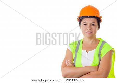 Attractive Woman Worker in Safety Jacket and Yellow Helmet on a white background