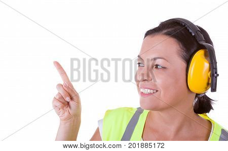Attractive Woman Worker in Safety Jacket and Protective Ear Headphones with Copyspace for Yours Design on a white background