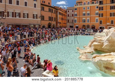 Rome Italy - May 16 2017: Tourists visiting the famous Trevi Fountain. Trevi Fountain is one of the main attractions of the city. Rome. Italy.