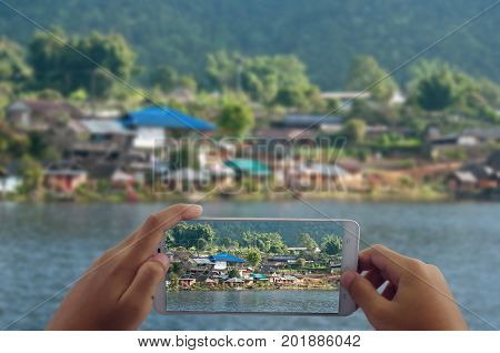photograph village by phone concept for travel