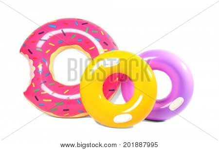 Three inflatable swim rings isolated on white