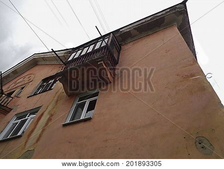 House. Balcony. Architecture. Fragment of old house with balcony. Old architecture. Architectural background.