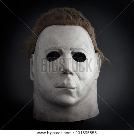 Studio portrait of a Michael Myers mask from John Carpenter's Halloween movie franchise on black background with dramatic lighting. The mask used in the 1978 movie was an altered Captain Kirk mask