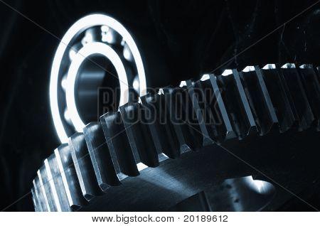 gears mechanism in blue against black velvet idea