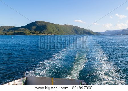 View of the stern of a ferry in Norway with blue sky