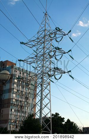 Electric towers with wires. Electric high voltage tower with electric line against clear blue sky.