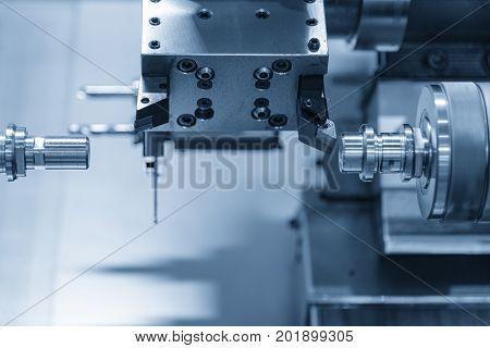 CNC lathe machine or Turning machine drilling the steel rod .Hi technology manufacturing process.