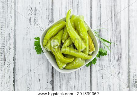 Green Chilis (filled With Cheese) On Wooden Background (selective Focus)