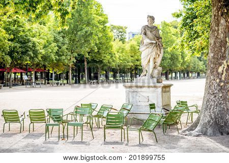 Famous green metal chairs at the Tuileries park in Paris