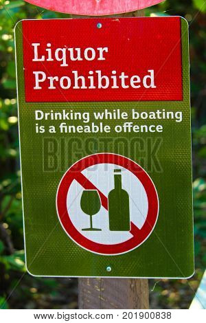 A liquor prohibited drinking while boating is an offense sign.