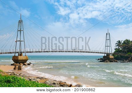 Bridge to the island with a Buddhist temple Matara Sri Lanka