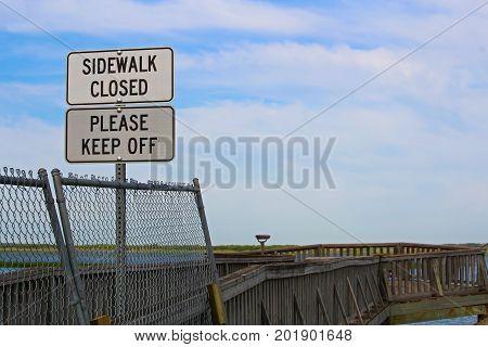 Sidewalk Closed, Please Keep Off Signs Closing A Sidewalk
