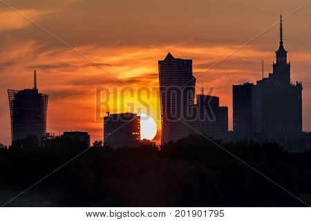 Burning sky during sunset over Warsaw city Poland