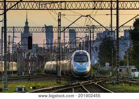Warsaw city downtown and railways junction during sunset