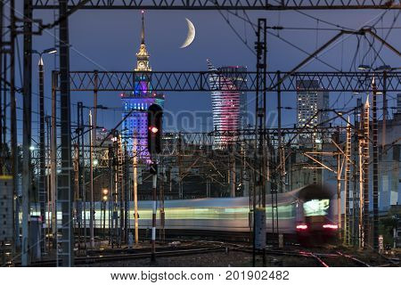 Partial moon over Warsaw city and train junction Poland