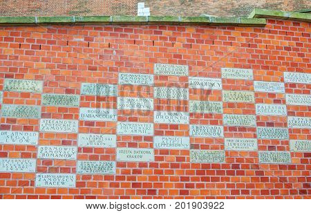 Krakow/Poland- August 14, 2017: Wawel Royal Castle, gratitude tablets with names of benefactors, who supported the renovation and restoring of Wawel