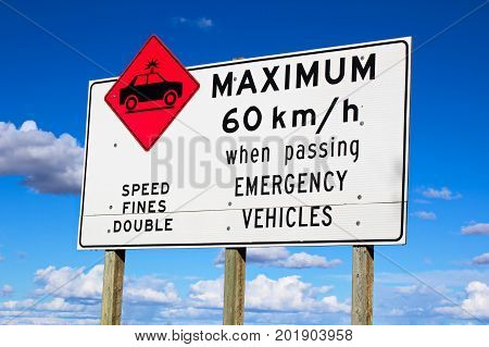 Maximum Speed While Passing Emergency Vehicles Sign
