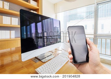 smart phone in modern meeting room with computer on table