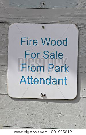 A Fire Wood For Sale From Park Attendant Sign