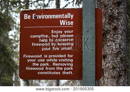 Be Environmentally Wise Sign Asking To Conserve Wood