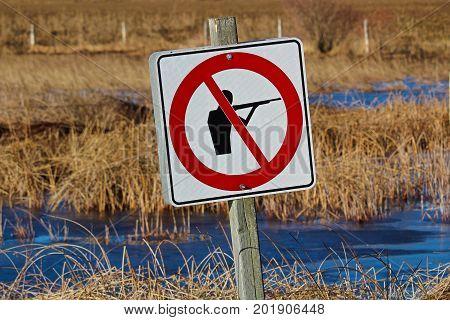 No Hunting Sign Along A Nature Path