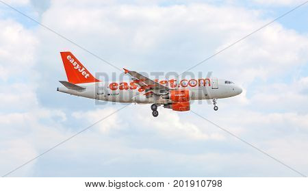 Airplane Of Easyjet Before Landing / After Takeoff, Sky With Clouds