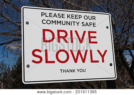 Drive Slowly Sign In A Community Area