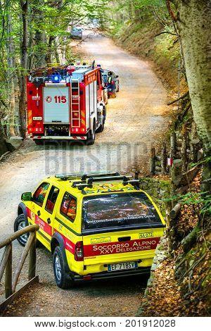 Modena Italy 27 Aug 2017: Mountain rescue car (italian Soccorso Alpino vehicle ) and fire truck