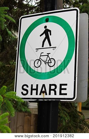 A Pedestrian Cyclist Share Path Sign That Has Been Vandalized To Show A Skateboarder Instead