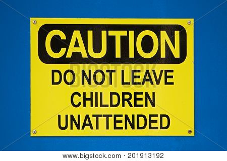 Caution Do Not Leave Children Sign On A Blue Background
