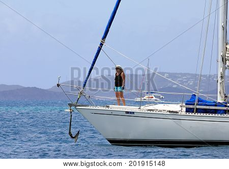 British Virgin Islands - April 9, 2015. Woman on the sailing boat in BVI