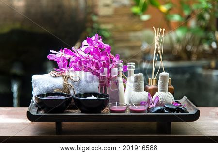 Thai Spa Treatments aroma therapy salt and sugar scrub and rock massage with orchid flower. Healthy Concept. select and soft focus