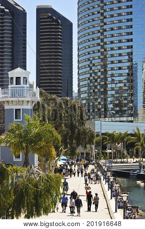 SAN DIEGO, CALIFORNIA, JUNE 9: Seaport Village on June 9, 2017, in San Diego, California. Tourists stroll the waterfront at Seaport Village iin San Diego popular with locals and tourists alike.