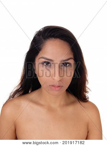A portrait image of a young woman without any makeup looking sad into the camera isolated for white background