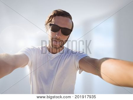 Digital composite of man taking casual selfie photo in front of blurred background