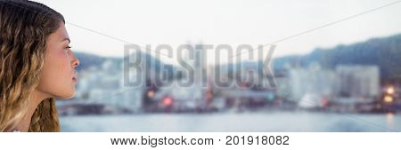 Digital composite of Side portraiture of millennial woman against blurry skyline