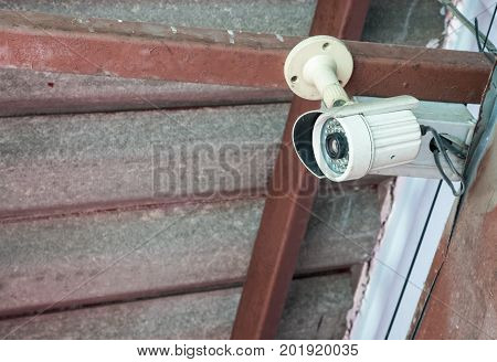 Security surveillance camera in the compact size for watching around the home office copy space.