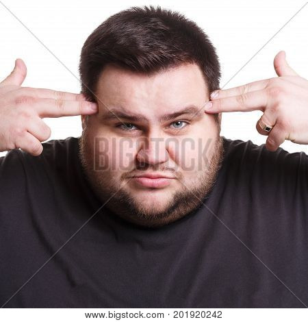Stressed exhausted man with fingers on temple suffering from headache, white isolated studio background