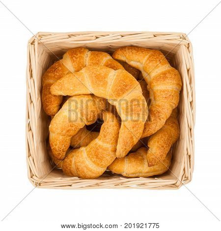 Basket with freshly baked homemade croissants isolated on white background top view