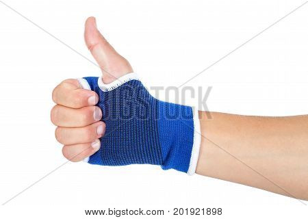 Close up picture of male with blue elastic bandage on his wrist showing thumbs up on isolated background