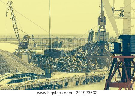 Industrial port area with cranes, industrial landscape, toned