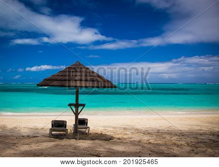 Tiki Hut and lounger on a beach on the Caribbean