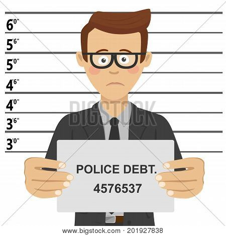 Young businessman with glasses posing for mugshot holding a signboard with police debt text