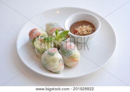 Healthy Fresh Spring Rolls. A see-through rice paper rolled around pork