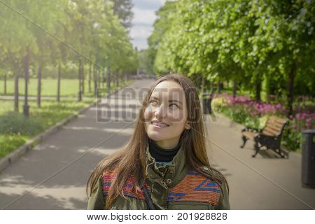 Young Smiling Woman Daydreaming Looking Up Into The Sky