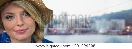 Digital composite of Portraiture of millennial woman with sun hat against blurry skyline