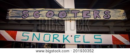 Snorkels and Scooters Rental Sign  rental sign on Turks and Caicos island in the Caribbean. poster