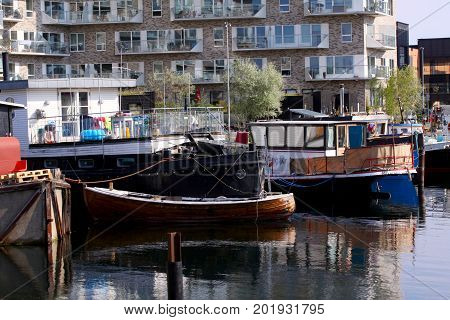 Houseboat anchored on a canal in the capital city of Copenhagen. Copenhagen, August 29, 2017