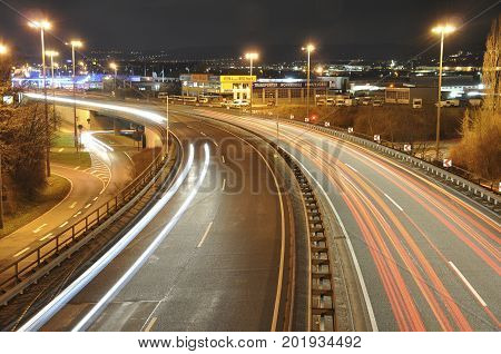14.11.2011 Koblenz Germany - Car lights on a german highway construction site with signs at night, long exposure photo of traffic