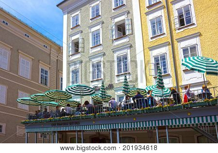 Salzburg, Austria - May 01, 2017: The people resting at cafe Tomaselli at old town in Salzburg, Austria on May 01, 2017.